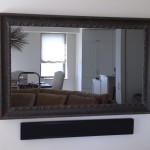 flat screen with mirror cover